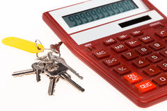 The red calculator with a keys on a white background Royalty Free Stock Image