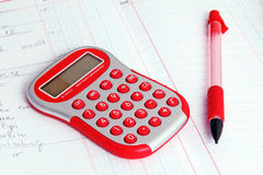 Red calculator on a notebook Stock Photography