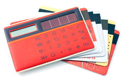 Red calculator and plastic cards Stock Images