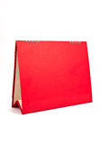 Red calendar. Red blank desktop calendar with isolated on white background stock photo