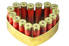 Red 12 caliber bullet shotgun shells in tin heart shape box. Gift for real man. Isolated on white background Stock Photography