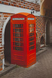 Red call-box on a background a brick wall Royalty Free Stock Photography