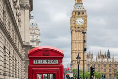 Red call box at Parliament square near Big Ben in London Stock Images