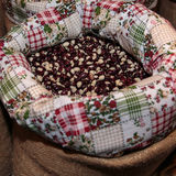 Red Calypso Beans inside Jute Sack for Sale at Market Royalty Free Stock Photography