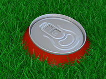 Red can of beer in a grass Stock Photos