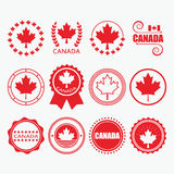 Red Canada flag emblems, stamps and design elements set. On white background Stock Photo
