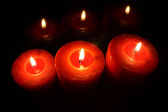 Red candels. In the dark Stock Image