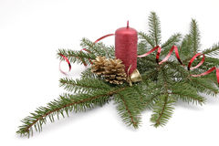 Red candle. With the twig of the spruce and the cones Stock Image