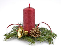 Red candle. With the twig of the spruce and the cone Royalty Free Stock Images