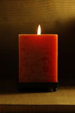Red candle. A single burning red candle royalty free stock images