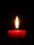 Red candle. Burning red candle  on black Stock Image
