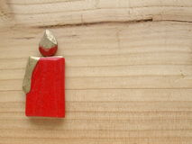 Red candle. On wooden board Royalty Free Stock Image