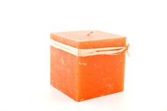 Red candle. Candle- orange-coloured  candle on the white background Royalty Free Stock Photos