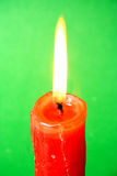 Red candle. Lone red candle shining brightly Stock Photo