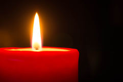 Red candle against a dark background Royalty Free Stock Image