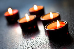 Red candle and aqua drop Stock Images