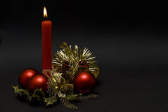Red candle, balls and tinsel. Royalty Free Stock Photography