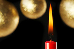 Red Candle and baubles Stock Image