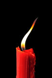 Red candle in black background Royalty Free Stock Images