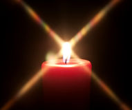 Red candle with black background Stock Images