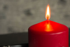Red candle on a black-gray background Royalty Free Stock Photo