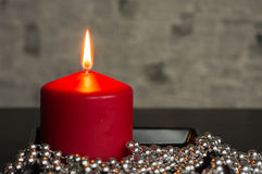 Red candle on a black-gray background Stock Photo