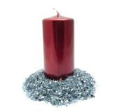 Red candle on blue glitter Stock Photography