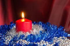 Red candle with a blue and silver decor Royalty Free Stock Image