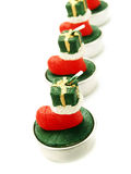 Red candle boots as Christmas ornaments Royalty Free Stock Images