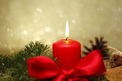 Red candle with bow Royalty Free Stock Photo