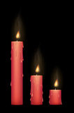 A red candle burning Royalty Free Stock Images