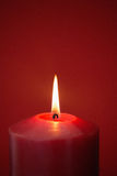 Red candle burning brightly Royalty Free Stock Photo