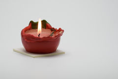 Red candle. Red burning candle on white background Royalty Free Stock Photos