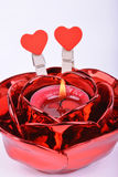 Red candle in candlestick  and red hearts on white background Royalty Free Stock Photography