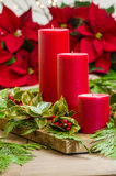 Red candle centerpiece with greens Royalty Free Stock Photos