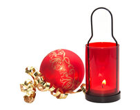 Red candle with Christmas ball Royalty Free Stock Photo