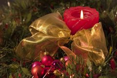 Red Candle and Christmas balls. With gold bow Stock Images