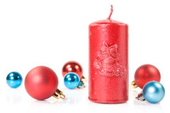 Red   candle and christmas baubles Royalty Free Stock Photo