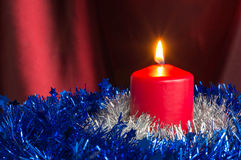 Red candle with a Christmas decor Royalty Free Stock Photography