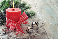Red candle. With christmas decor on wooden background Stock Images