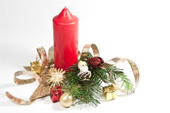 Red candle and christmas decoration. Christmas decoration with a red candle Stock Photo