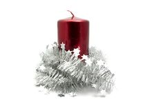 Red candle with christmas decoration Royalty Free Stock Images