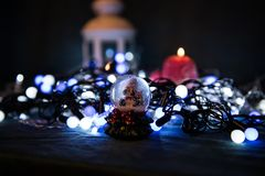 A red candle with Christmas lights in the atmospheric light Stock Photos
