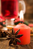 Red Candle and Christmas spices close-up Stock Photos