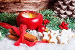 Red candle and cinnamon star to advent Stock Images