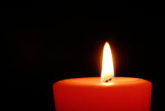 Red candle in the dark Royalty Free Stock Photos