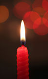 Red candle on dark background. Candle on dark bokeh background Stock Images