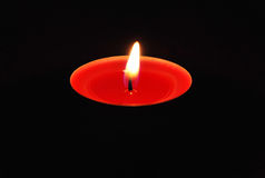 Red candle in the dark Stock Photos