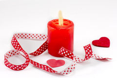 Red candle and decorative tape Royalty Free Stock Images
