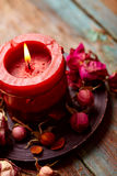 Red candle with dry rose Stock Photo